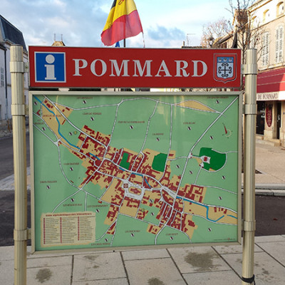 Outdoor village street sign with map of Pommard France